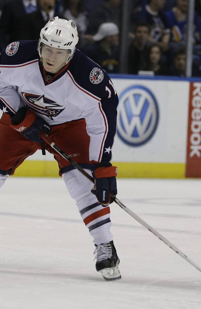 Columbus Blue Jackets' Matt Calvert handles the puck during the first period of an NHL hockey game against the St. Louis Blues Friday, April 5, 2013, in St. Louis