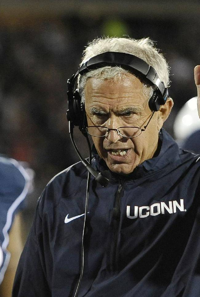 In this Sept. 21, 2013 file photo, Connecticut head coach Paul Pasqualoni, right, gestures to his team during the second half of an NCAA college football game against Michigan at Rentschler Field in East Hartford, Conn. Paqualoni was fired Monday, Sept. 30, 2013, after the Huskies lost the first four games of the season