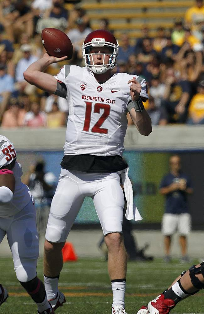 Washington State quarterback Connor Halliday (12) passes against California during the first half of an NCAA college football game in Berkeley, Calif., Saturday, Oct. 5, 2013