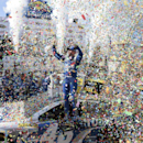 Jimmie Johnson celebrates in Victory Lane after he won the NASCAR Sprint Cup series auto race, Sunday, May 31, 2015, at Dover International Speedway in Dover, Del. (AP Photo/Nick Wass)