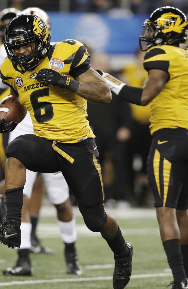 Missouri safety Braylon Webb (9) celebrates after intercepting the ball from quarterback Clint Chelf during the second half of the Cotton Bowl NCAA college football game, Friday, Jan. 3, 2014, in Arlington, Texas. (AP Photo/Brandon Wade)