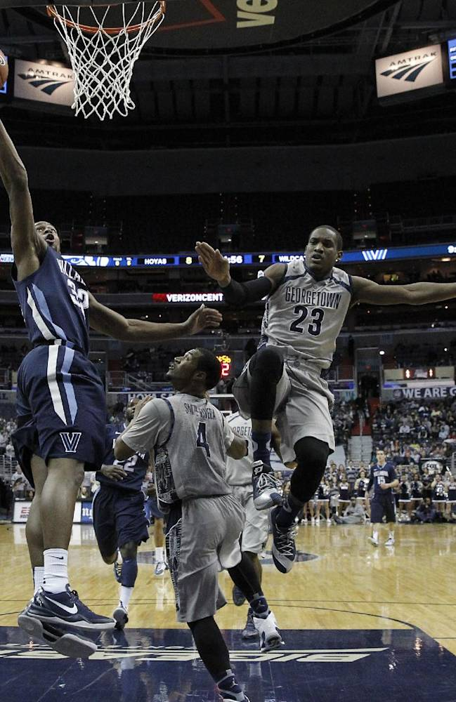 Villanova guard James Bell, left,  shoots the ball as Georgetown guard D'Vauntes Smith-Rivera (4) and forward Aaron Bowen (23) defend during the first half of an NCAA college basketball game, Monday, Jan. 27, 2014, in Washington