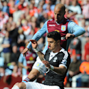 Aston Villa's Karim El Ahmadi, back, and Southampton's Jose Fonte battle for the ball during the English Premier League soccer match between Aston Villa and Southampton at Villa Park, in Birmingham, England, Saturday, April 19, 2014