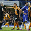 Hull's Jake Livermore gestures to the referee Chris Hoy after he had shown a yellow card to Chelsea's Diego Costa, second right, during their English Premier League soccer match between Chelsea and Hull City at Stamford Bridge stadium in London, Saturday,