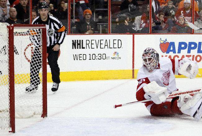 Detroit Red Wings goalie Jonas Gustavsson looks back at the goal scored by Philadelphia Flyers's Adam Hall who scored during the second period of an NHL hockey game, Tuesday, Jan. 28, 2014, in Philadelphia
