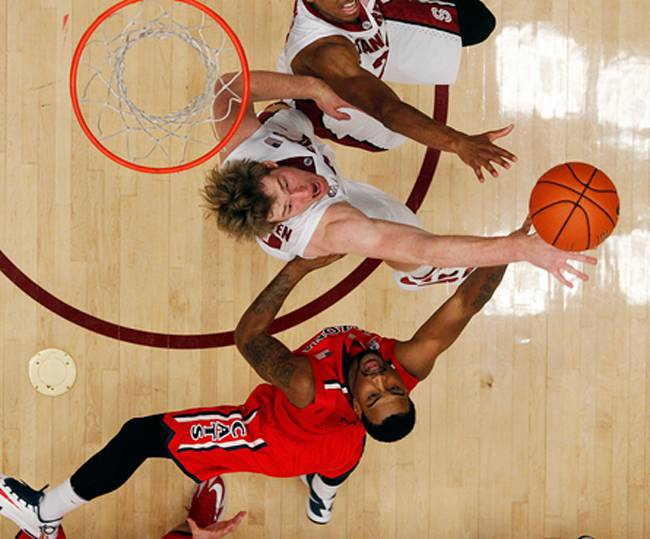 No. 1 Arizona survives to beat Stanford 60-57