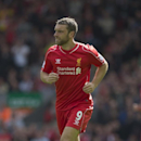 Liverpool's Rickie Lambert makes his debut during his team's 2-1 win against Southampton in their English Premier League soccer match at Anfield Stadium, Liverpool, England, Sunday Aug. 17, 2014