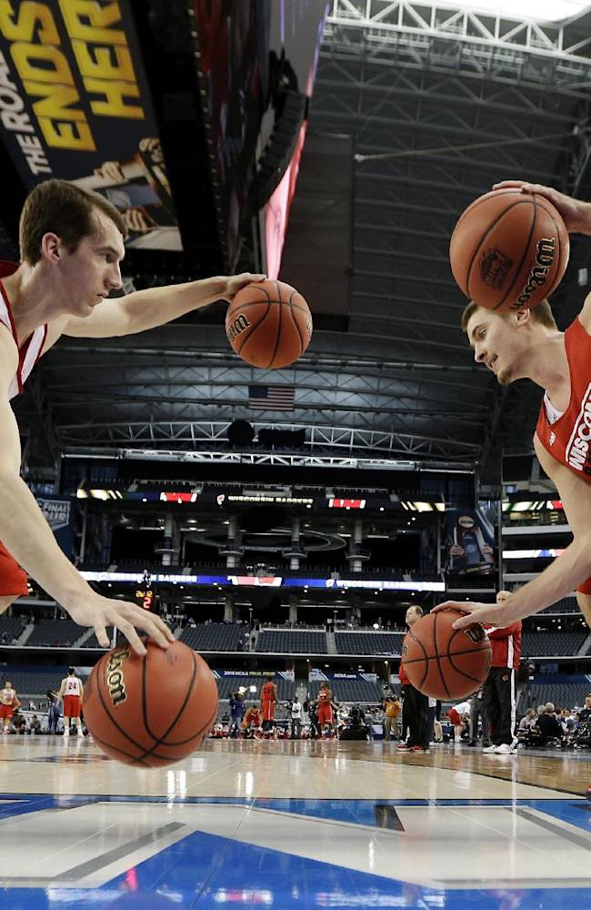 Wisconsin forward Zach Bohannon, left, and forward Aaron Moesch drill during practice for their NCAA Final Four tournament college basketball semifinal game Friday, April 4, 2014, in Dallas. Wisconsin plays Kentucky on Saturday, April 5, 2014