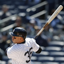 New York Yankees right fielder Carlos Beltran hits a solo home run in the first inning of Game 1 of an interleague baseball doubleheader against the Chicago Cubs at Yankee Stadium in New York, Wednesday, April 16, 2014 The Associated Press