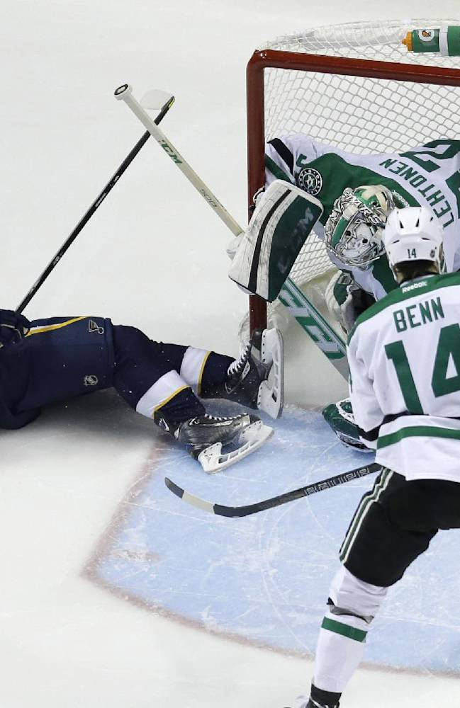 St. Louis Blues' Vladimir Sobotka (17), of the Czech Republic, falls as he scores past Dallas Stars goalie Kari Lehtonen, of Finland, and Jamie Benn (14) during the first period of an NHL hockey game Saturday, Nov. 23, 2013, in St. Louis