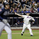 New York Mets starting pitcher Bartolo Colon attempts to throw out Atlanta Braves' Freddie Freeman at first base during the third inning of a baseball game Saturday, April 19, 2014, in New York. Two runs scored on a Colon throwing error on the play The As