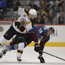 Boston Bruins center Patrice Bergeron (37) collides with Colorado Avalanche left wing Patrick Bordeleau (58) the second period of an NHL hockey game in Denver on Friday, March 21, 2014 The Associated Press