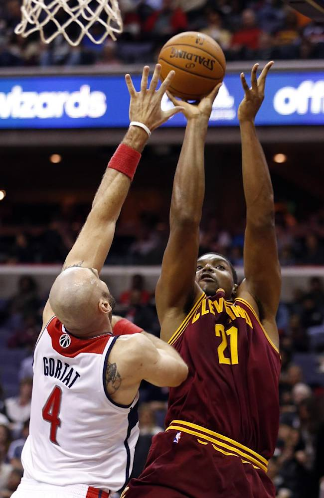 Cleveland Cavaliers center Andrew Bynum (21) shoots over Washington Wizards center Marcin Gortat (4), from Poland, in the first half of an NBA basketball game on Saturday, Nov. 16, 2013, in Washington