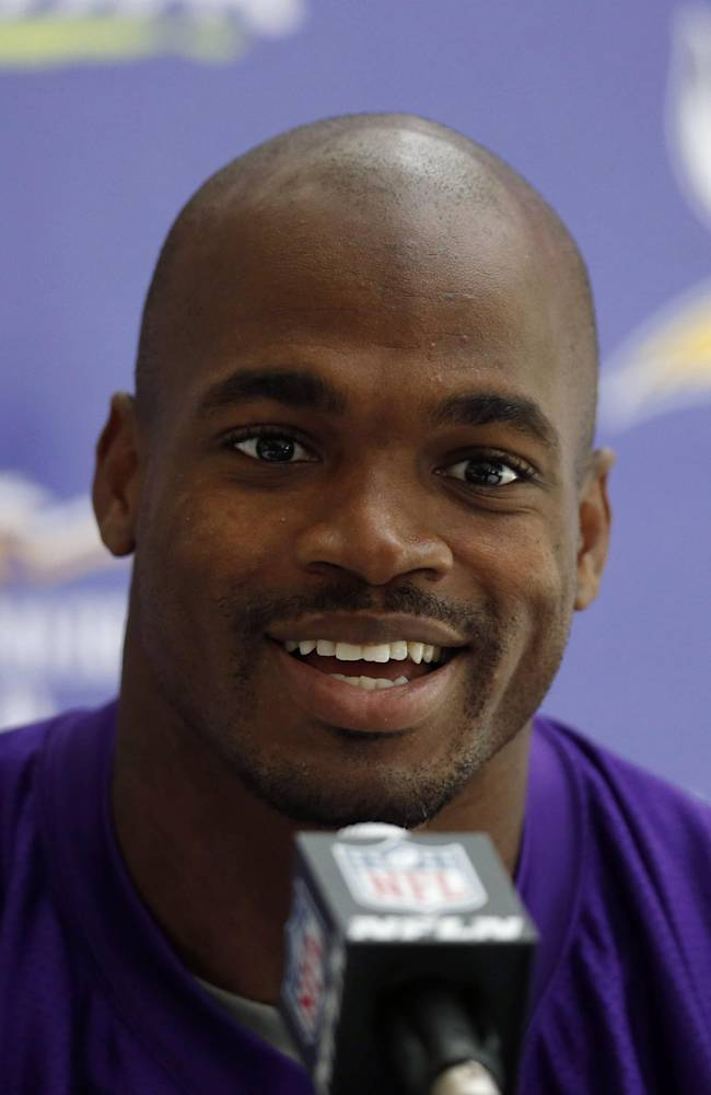 Minnesota Vikings' running back Adrian Peterson smiles, during a press conference at the Grove Hotel in Watford, north London, Wednesday, Sept. 25, 2013. The Vikings play Pittsburgh Steelers on Sunday in a NFL regular season football game at Wembley Stadium in London
