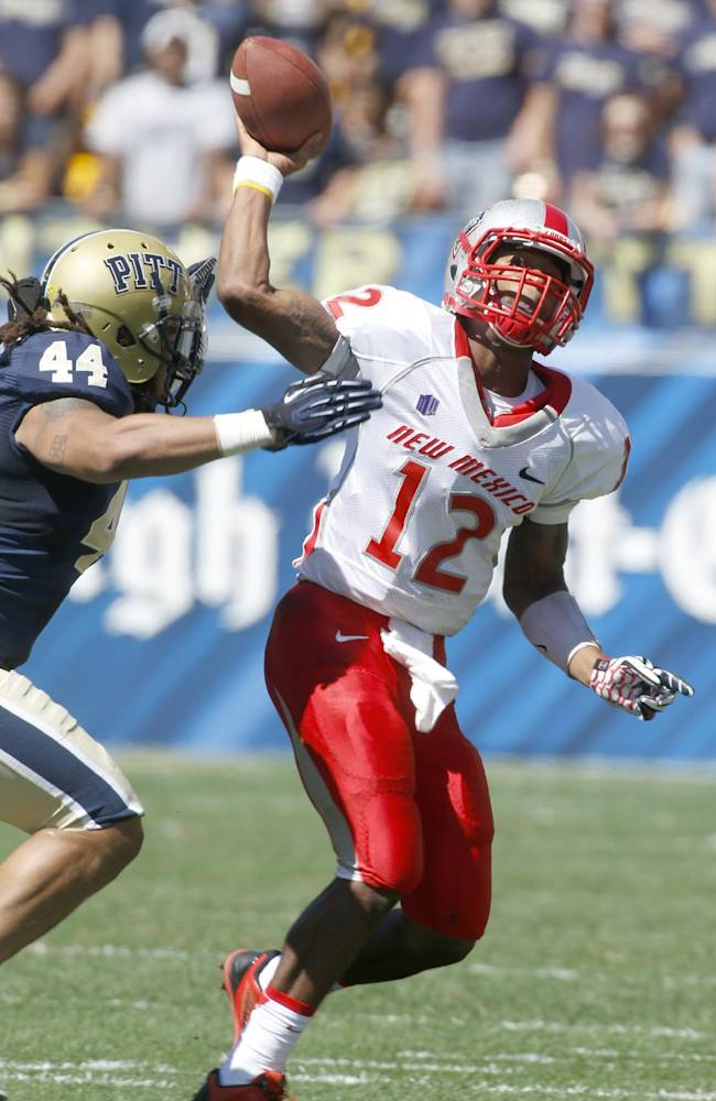 New Mexico quarterback Clayton Mitchem (12) gets a pass off as Pittsburgh linebacker Shane Gordon (44) pressures in the second quarter of an NCAA football game on Saturday, Sept. 14, 2013, in Pittsburgh