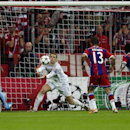 Manchester City's goalkeeper Joe Hart, center, saves the ball during the Champions League Group E soccer match between FC Bayern Munich and Manchester City at Allianz Arena in Munich, southern Germany, Wednesday Sept. 17, 2014
