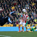 A shot from Norwich City's Robert Snodgrass, second right, is saved by Stoke City goalkeeper Asmir Begovic, left, during their English Premier League soccer match at Carrow Road, Norwich, England, Saturday, March 8, 2014