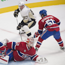 Pittsburgh Penguins' Sidney Crosby (87) moves in on Montreal Canadiens goaltender Carey Price as Canadiens' David Desharnais (51) defends during overtime of an NHL hockey game Saturday, Jan. 10, 2015, in Montreal The Associated Press