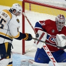 Nashville Predators' Craig Smith (15) swings at the puck in front of Montreal Canadiens goalie Carey Price (31) during the third period of an NHL hockey game Tuesday, Jan. 20, 2015, in Montreal The Associated Press
