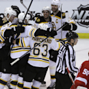 Detroit Red Wings goalie Jonas Gustavsson (50) of Sweden skates by as the Boston Bruins celebrate their 3-2 overtime win in Game 4 of a first-round NHL hockey playoff series in Detroit, Thursday, April 24, 2014 The Associated Press