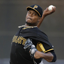 Pittsburgh Pirates starting pitcher Edinson Volquez (36) delivers a warmup pitch before facing the New York Yankees in a spring exhibition baseball game in Tampa, Fla., Friday, March 21, 2014 The Associated Press