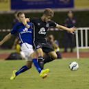 Leicester's Marc Albrighton, left, fights for the ball with Everton's Luke Garbutt during their friendly soccer match at Suphachalasai stadium in Bangkok, Thailand Sunday, July 27, 2014 .Leicester City beat Everton 1-0