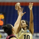 Vanderbilt's Christina Foggie, right, shoots over Saint Joseph's Natasha Cloud, left, during the first half of a first-round game in the women's NCAA college basketball tournament In Storrs, Conn., Saturday, March 23, 2013. (AP Photo/Jessica Hill)