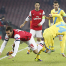Arsenal's Santi Cazorla, left, and Napoli forward Dries Mertens of Belgium fight for the ball during a Champions League, group F soccer match between Arsenal and Napoli, at the Naples San Paolo stadium, Italy, Wednesday, Dec. 11, 2013