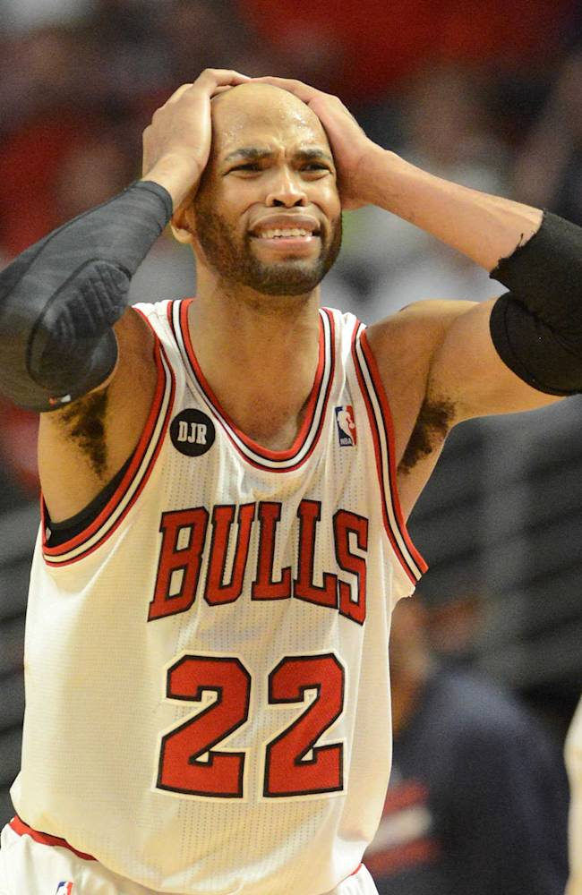 Chicago Bulls forward Taj Gibson (22) reacts as things start going the Wizards' way  during Game 2 in an opening-round NBA basketball playoff series Tuesday, April 22, 2014, in Chicago. The Wizards won 101-99