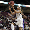 Texas A&M's Chelsea Jennings (13) drives to the basket during the first half of an NCAA college basketball exhibition game against the Oklahoma City Stars on Saturday, Nov. 8, 2014, in College Station, Texas