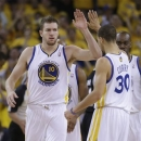 Golden State Warriors forward David Lee, left,  celebrates after scoring with teammate Seth Curry, right, during the second quarter of Game 3 of a Western Conference semifinal NBA basketball playoff series against the San Antonio Spurs in Oakland, Calif., Friday, May 10, 2013. (AP Photo/Jeff Chiu)
