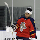 In this Monday, Sept. 21, 2014, photo, Florida Panthers goalie Roberto Luongo, left, skates on the ice during NHL hockey training camp, Monday, Sept. 21, 2014, in Coral Springs, Fla. The franchise that hasn't won a playoff series since 1996 is once again