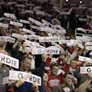 "Fans wave ""Get Well Gordie"" signs for Detroit Red Wings legend Gordie Howe during the first period of an NHL hockey between the Detroit Red Wings and Los Angeles Kings Friday, Oct. 31, 2014, in Detroit. Howe suffered a stroke on Sunday. (AP Photo/Duane Burleson)"