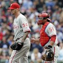 Philadelphia Phillies starter A.J. Burnett, left, talks with catcher Carlos Ruiz during the first inning of a baseball game against the Chicago Cubs in Chicago, Sunday, April 6, 2014 The Associated Press
