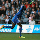 Chelsea's Demba Ba celebrates after scoring his team's opening goal during their English Premier League soccer match against Swansea City at the Liberty Stadium, Swansea, Wales, Sunday, April 13, 2014