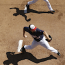 Minnesota Twins pitchers Phil Hughes, below, and Anthony Swarzak, legs only at top, work out in the bullpen before an exhibition baseball game against the Boston Red Sox, Saturday, March 1, 2014, in Fort Myers, Fla The Associated Press