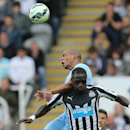 Manchester City's Fernando, top, vies for the ball with Newcastle United's Moussa Sissoko, bottom, during their English Premier League soccer match at St James' Park, Newcastle, England, Sunday, Aug. 17, 2014
