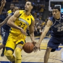 Marquette's Trent Lockett, left, has the ball stripped by Georgetown's Otto Porter during the first half of an NCAA college basketball game Saturday, Jan. 5, 2013, in Milwaukee. (AP Photo/Tom Lynn)