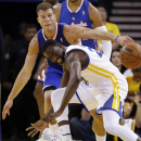 Los Angeles Clippers' Blake Griffin, top, strips the ball from Golden State Warriors' Draymond Green during the first half in Game 3 of an opening-round NBA basketball playoff series, Thursday, April 24, 2014, in Oakland, Calif The Associated Press