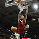 Miami Heat's Chris Andersen (11) dunks in front of Milwaukee Bucks' Brandon Knight during the first half of an NBA basketball game Saturday, March 29, 2014, in Milwaukee The Associated Press