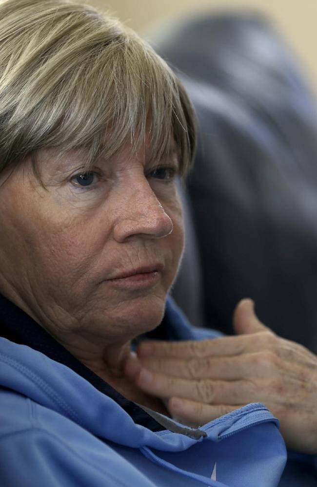 In this Wednesday, Dec. 18, 2013, photo, North Carolina women's basketball coach Sylvia Hatchell reflects on her experience with leukemia, during an interview at her home in Chapel Hill, N.C. Hatchell has temporarily stepped away from her coaching duties to focus on her treatment
