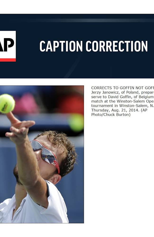 CORRECTS TO GOFFIN NOT GOFFEN  - Jerzy Janowicz, of Poland, prepares to serve to David Goffin, of Belgium, in their match at the Winston-Salem Open tennis tournament in Winston-Salem, N.C., Thursday, Aug. 21, 2014