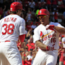 St. Louis Cardinals' Kolten Wong, right, is congratulated by teammate Pete Kozma after hitting a two-run home run during the seventh inning of a baseball game against the Pittsburgh Pirates Monday, Sept. 1, 2014, in St. Louis. (AP Photo/Jeff Roberson)