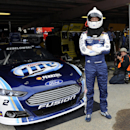 Brad Keselowski looks on from the garage during practice for Sunday's NASCAR Sprint Cup series auto race, Friday, Sept. 27, 2013, at Dover International Speedway in Dover, Del. (AP Photo/Nick Wass)