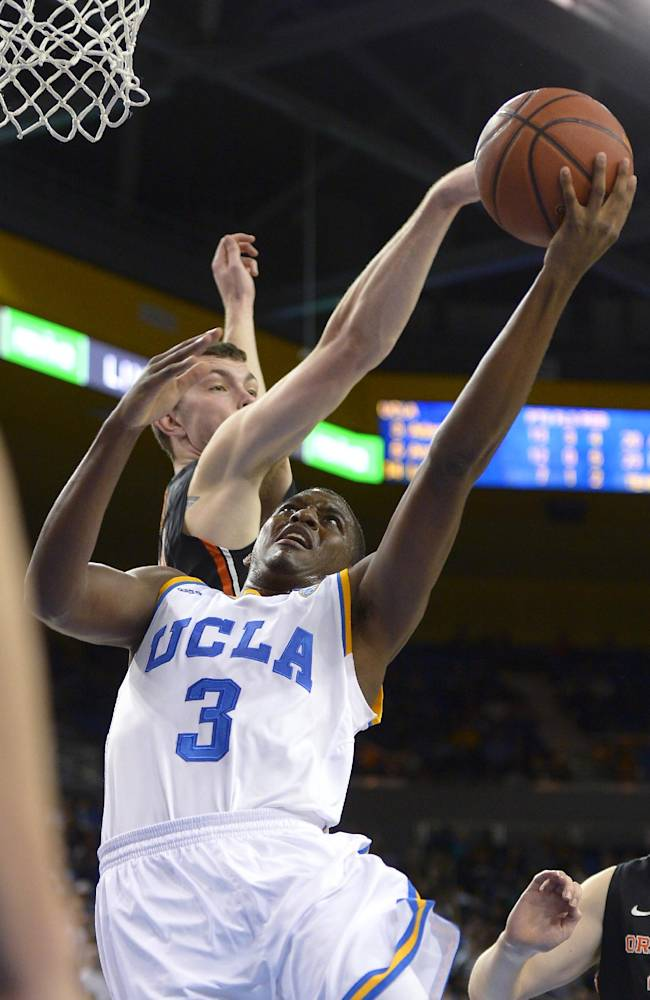UCLA guard Jordan Adams, right, puts up a shot as Oregon State center Angus Brandt defends during the second half of an NCAA college basketball game, Sunday, March 2, 2014, in Los Angeles. UCLA won 74-69
