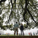 Golf patrons wander the foggy grounds during player practice rounds ahead of the 2015 Masters at Augusta National Golf Course in Augusta, Georgia April 8, 2015.   REUTERS/Mark Blinch