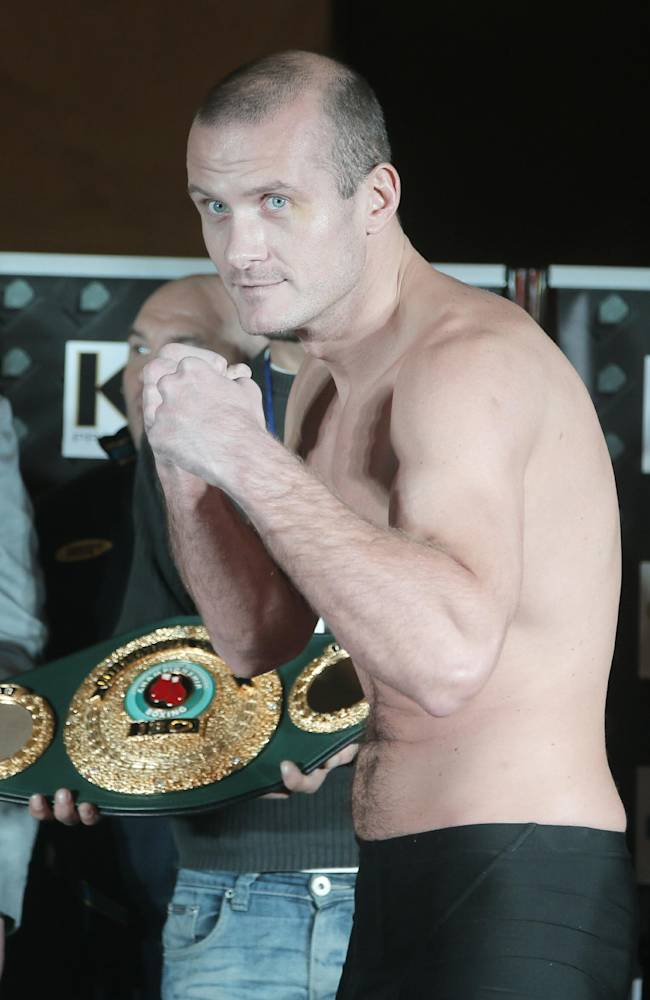 Ukranian boxer Vyacheslav Uzelkov poses for a photo at the official weigh in Kiev, Ukraine, Friday, Nov. 8, 2013. Uzelkov will fight with Jaidon Codrington from USA for vacant International Boxing Organization International light heavyweight title in Kiev on Saturday