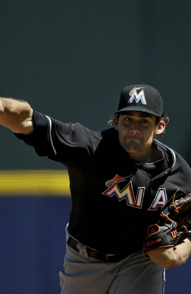Miami Marlins starting pitcher Nate Eovaldi throws in the first inning of a baseball game against the Atlanta Braves, Wednesday, April 23, 2014, in Atlanta