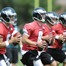 Philadelphia Eagles' Nick Foles (9) runs drills, Matt Barkley, right, G.J. Kinne, second from right and Mark Sanchez, left, during NFL football training camp on Sunday, July 27, 2014, in Philadelphia The Associated Press