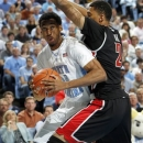North Carolina forward Desmond Hubert (14) battles for position against UNLV forward Khem Birch (2) during the first half of an NCAA college basketball game in Chapel Hill, N.C., Saturday, Dec. 29, 2012. (AP Photo/JIm R. Bounds)